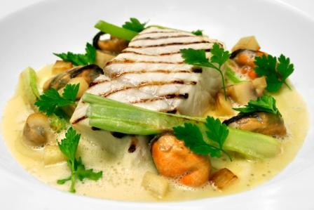 Grilled halibut with lightly smoked mussels, Paris mushroom and parsley jus