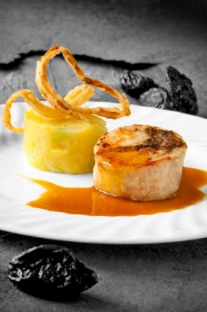 "Tournedos of rabbit stuffed with prunes, aged beer jus, ""Soubise"" potato and onion purée"