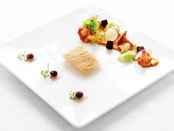 Oven-baked Halibut Albert and chanterelle mushrooms in diverse shapes and textures